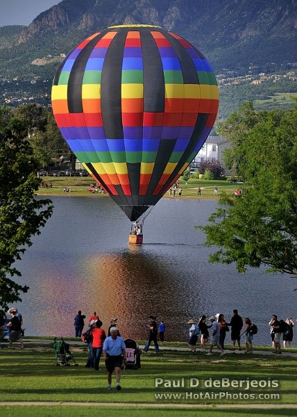 Hot Air Balloon touches down on Colorado Lake