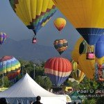 Hot Air Balloons inflating with Boulder Flatirons