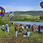 People watch Hot Air Balloons inflate in Colorado Mountains