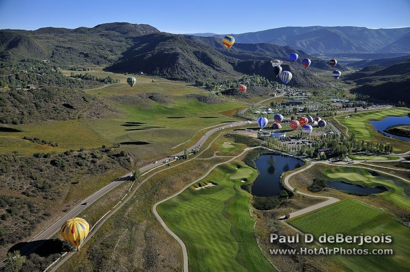 Hot Air Balloon over Mountains and Golf Course