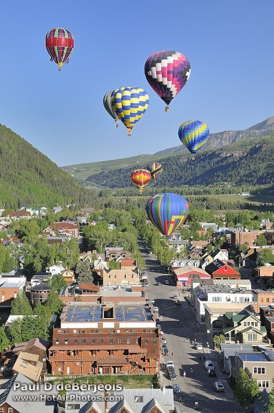 Hot Air Balloons rising over the city of Telluride Colorado