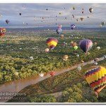 Many Hot Air Balloons Floating Over River