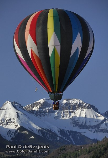 Snowy Mountain Peak and Hot Air Balloon