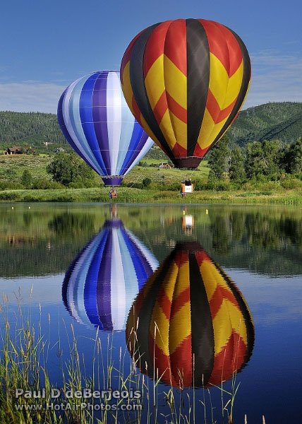 Two Balloons and their lake reflections