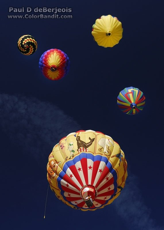 A view from the underside of several hot air balloons