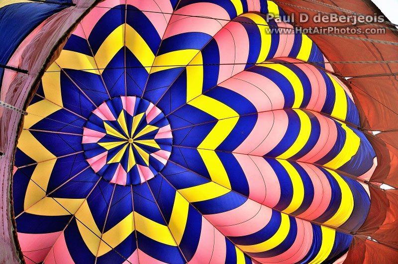 Colorful star inside an inflating hot air ballooon
